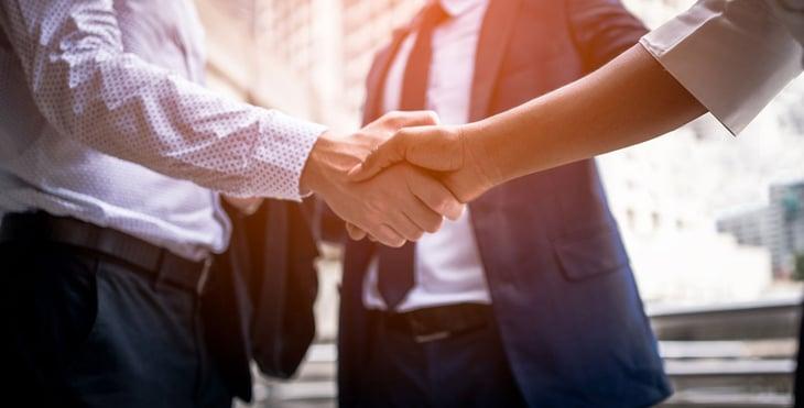 Reflections on leadership- Stewardship- business men shaking hands