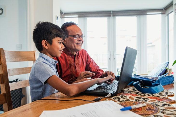 Grandchild-teaching-grandparent-technology