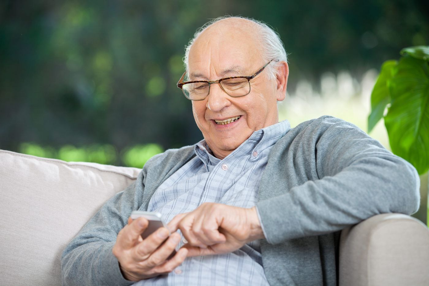 Essential Technology Older Adults   Man Using Smart Phone