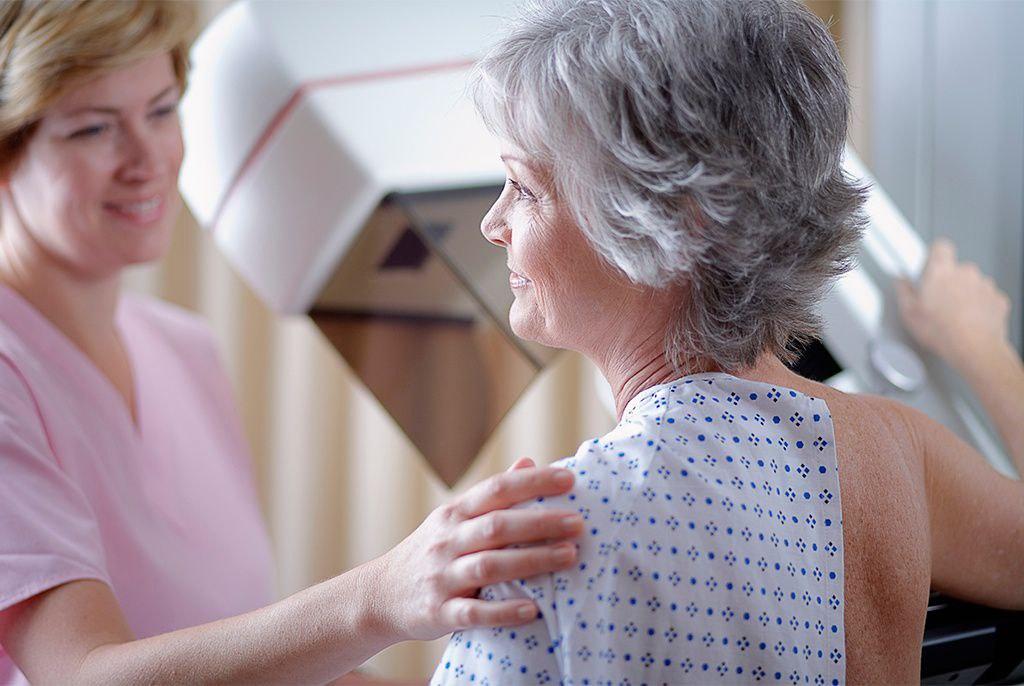 woman getting mammogram