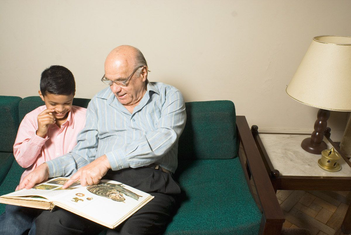 Mentoring Children | Senior Sharing Memories with Child