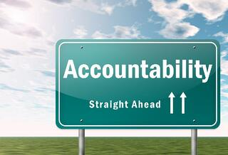 Reflections Accountability road sign.jpg
