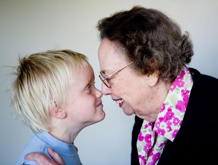 Senior-woman-touching-noses-child-boy