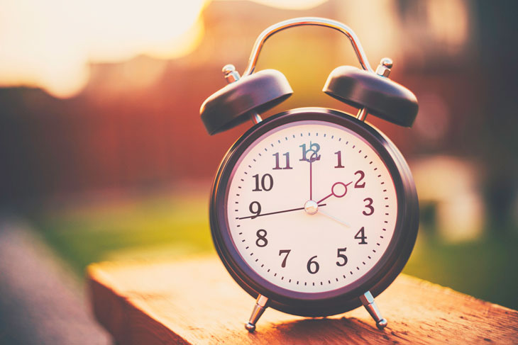 clock-sitting-on-fence