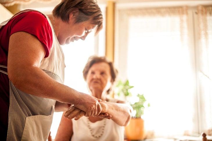 senior-hand-massage-compassionate-touch