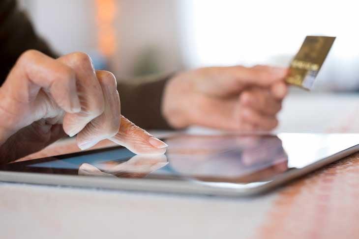 senior-online-shopping-on-ipad