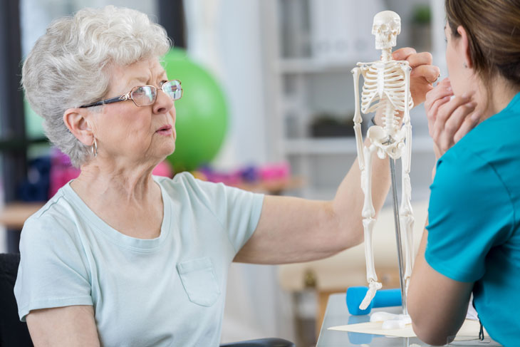 senior-woman-discussing-posture-with-physical-therapist