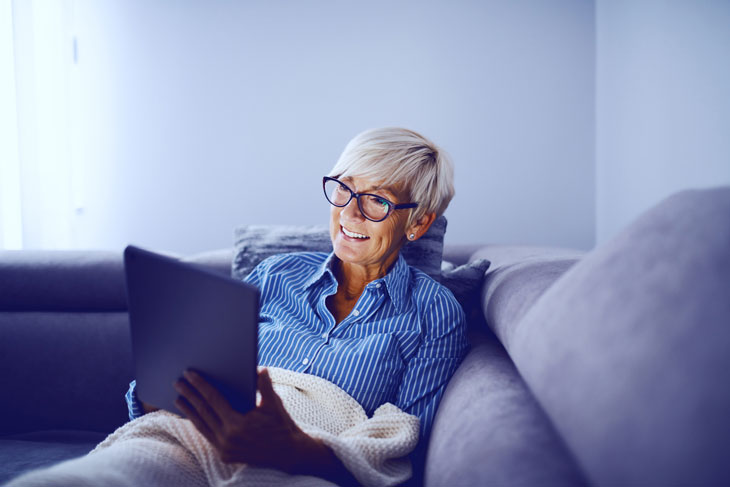 senior-woman-reading-ebook-technology-during-covid19