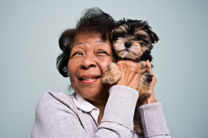 senior-woman-with-yorkie-puppy