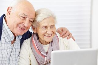Holistic Approach to Aging Well | Couple using Computer