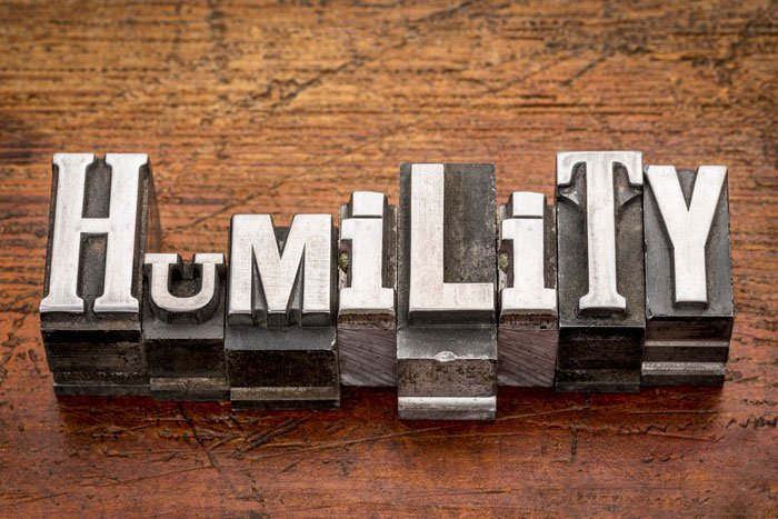 Humility spelled on wood
