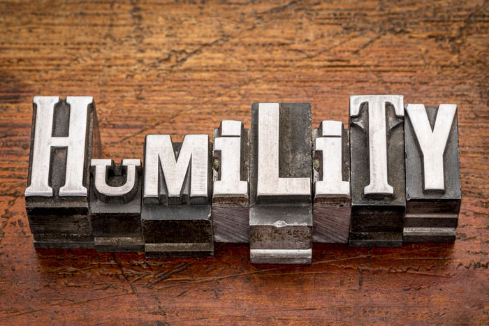 Humility spelled on wood