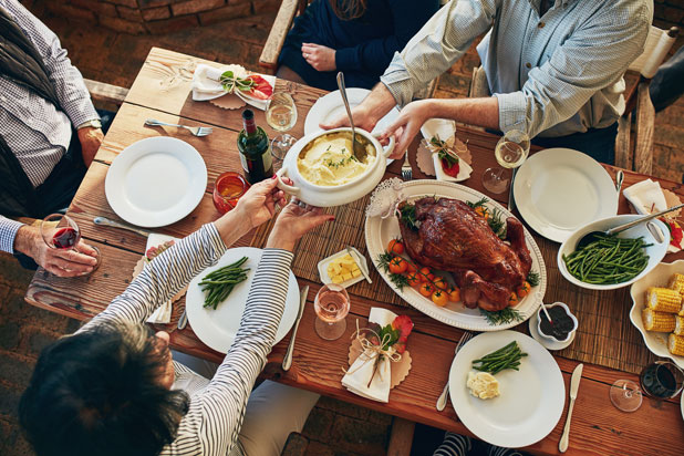 Passing food around Thanksgiving table