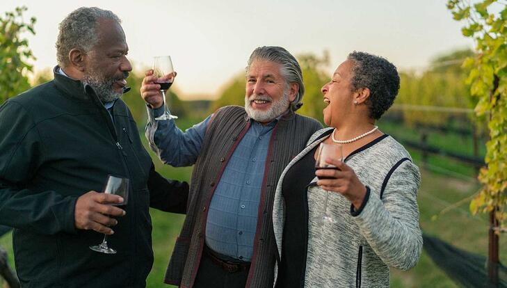 Lancaster Top Place to Retire- 3 People Sipping Wine in Vineyard