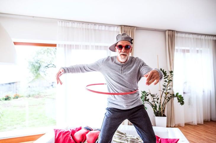 Senior man hula hooping