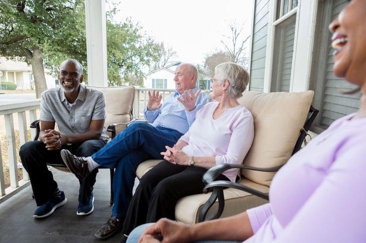 Seniors chatting on porch
