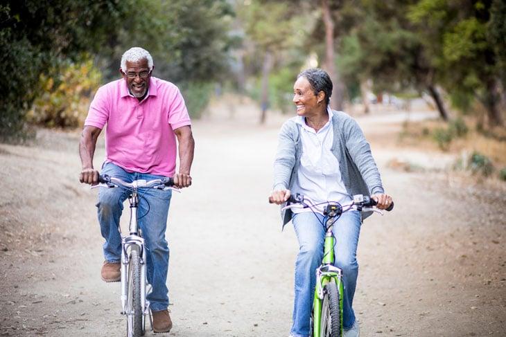 senior-man-and-woman-riding-bikes