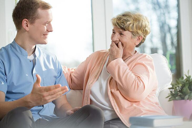 Caregiver Stress | Son Laughing with Mom