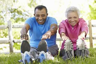 Holistic Approach to Aging Well | Couple Stretching Together