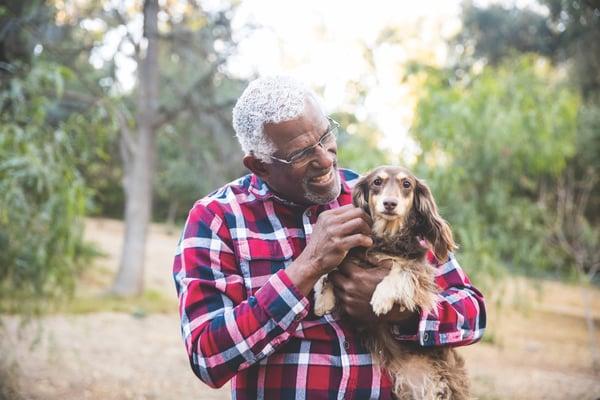 Older man holding dog
