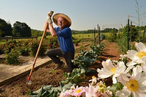 man gardening with shovel